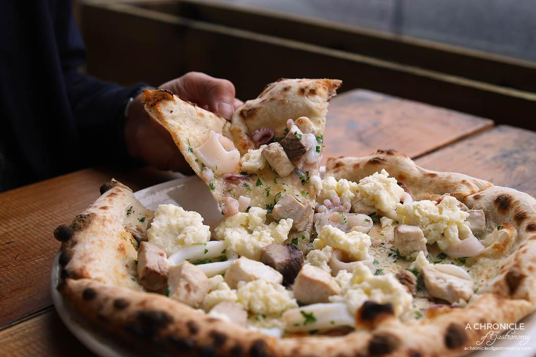 Shop 225 - Allo Scoglio Pizza Special - Stracciatella, swordfish, tuna, calamari, parsley ($28)