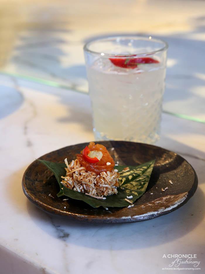 -Bang Pop Betel leaves - sticky prawns, orasted coconut, lime zest, chilli, ginger
